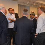 ONUG speakers Najam Ahmad and Subu Subrahmanyan talk with some attendees after their session