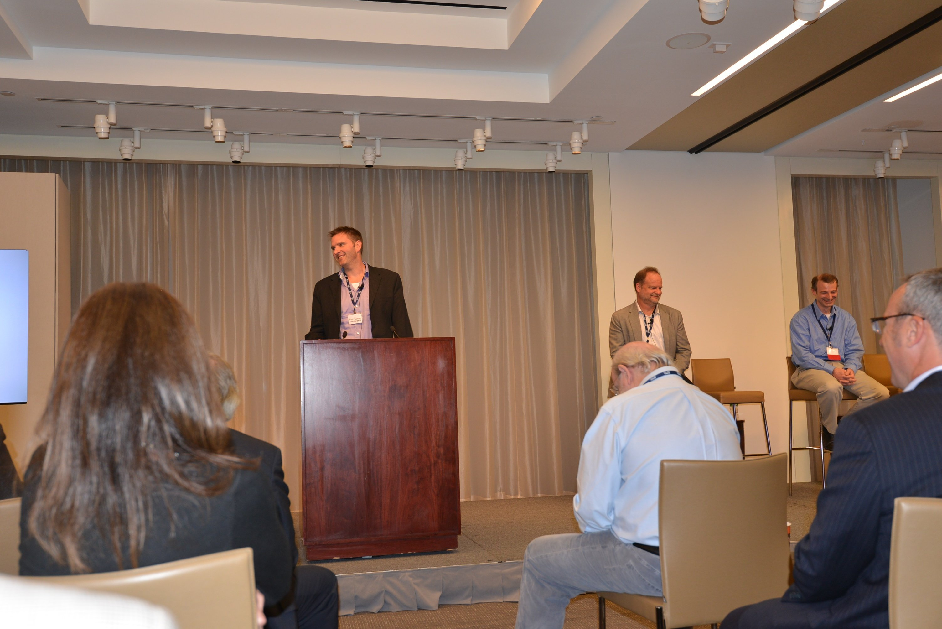 Brent Salisbury addresses the crowd during the SDN in University Environments session as fellow panelists Steve Wallace and Jim Kyriannis look on