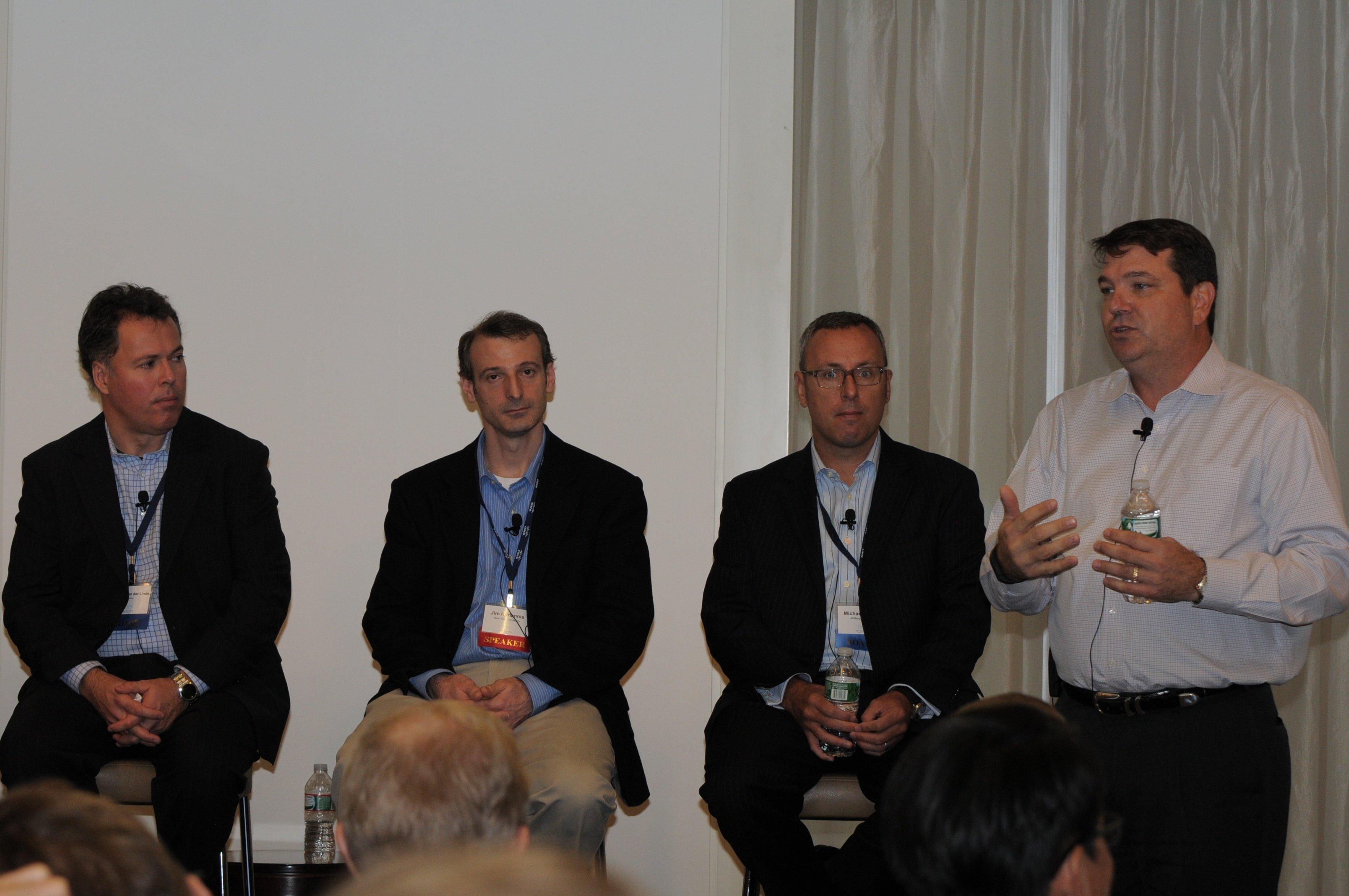 ONUG Board member Keith Shinn, presents use cases as fellow panel members Harmen Van der Linde, Jim Kyriannis, and Michael Payne look on
