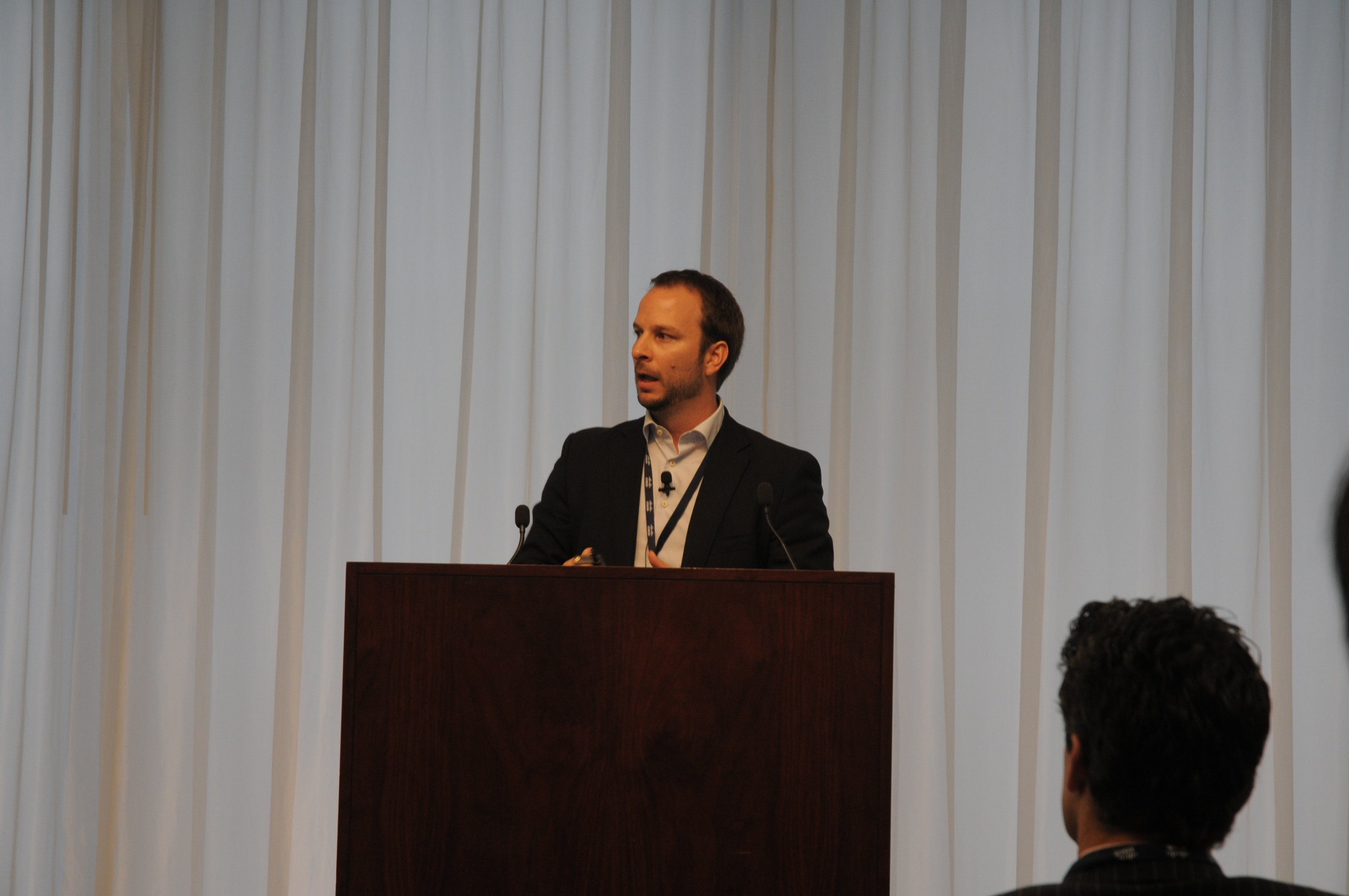 Jeff Gray, Glue Networks, introduces the Software-Defined WANs McAfee Case Study luncheon session