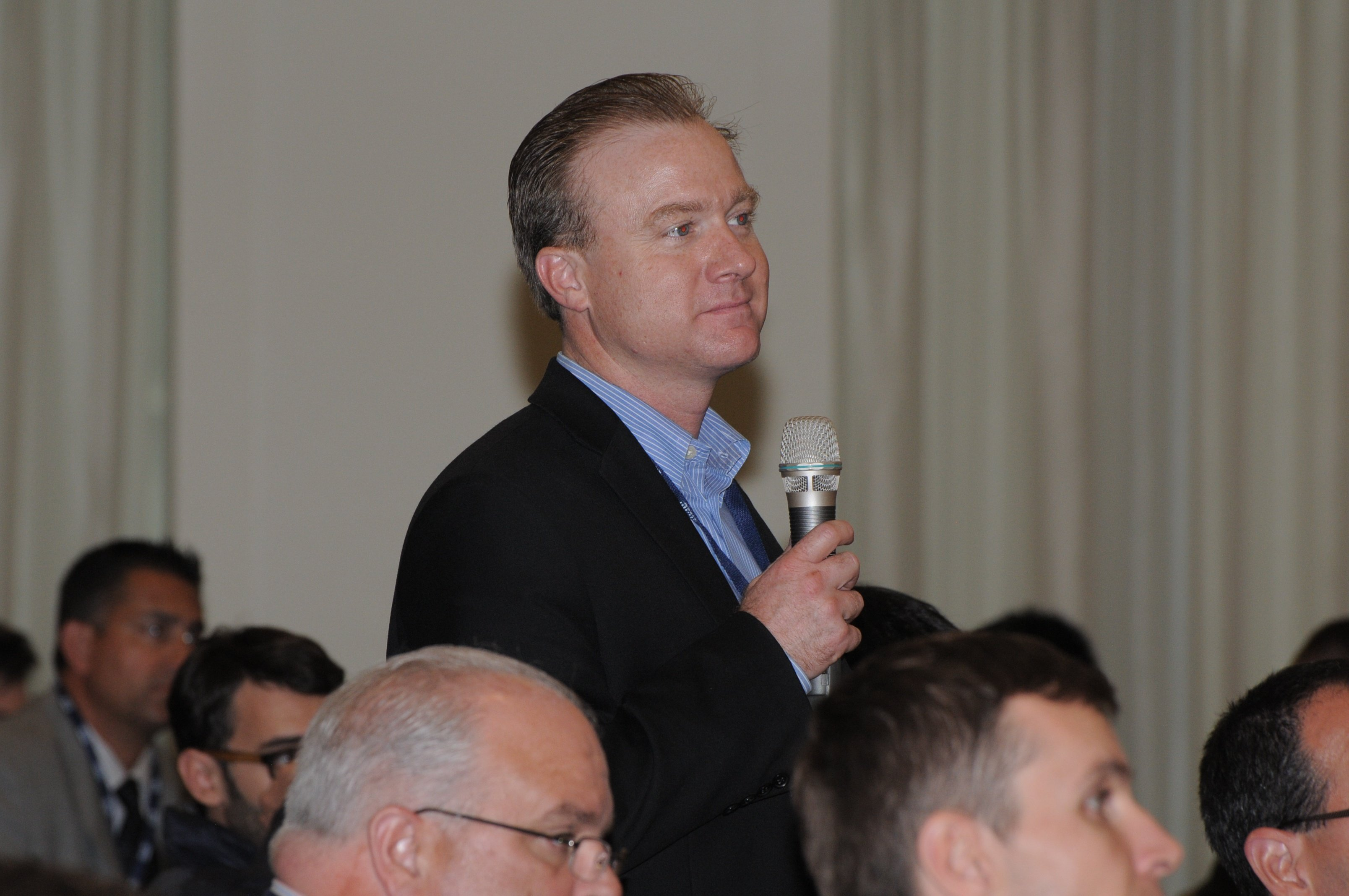 Lane Patterson, Equinix, asks a question from the audience during the Glue Networks and McAfee luncheon partnership session
