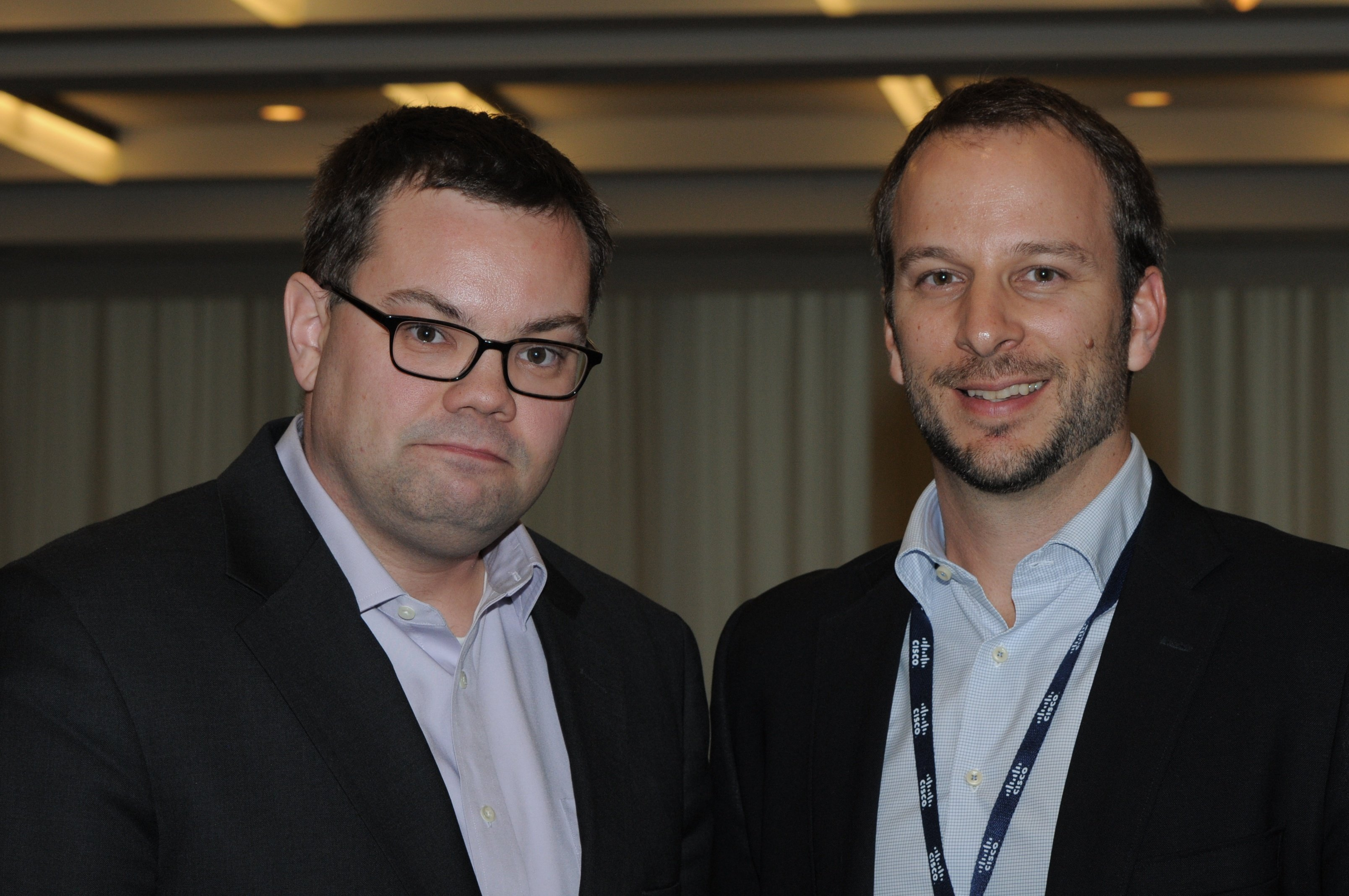 Josh Archambault, McAfee, and Jeff Gray, Glue Networks together after their luncheon partnership series speaking session
