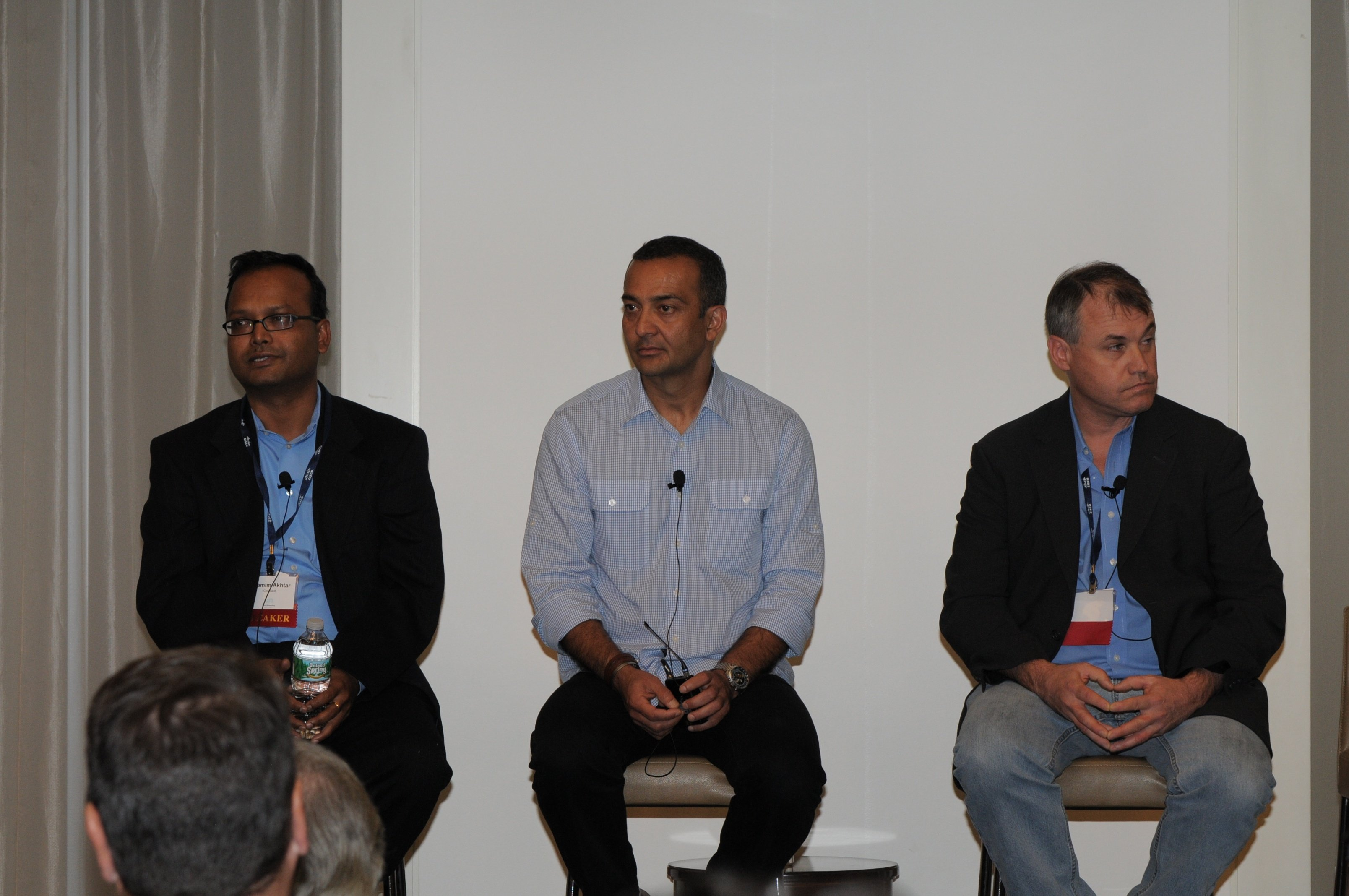 SDN Opportunities and Challenges in Content Providers, Public Cloud Operators, and Telcos panelists, Shamim Akhtar of Comcast, Najam Ahmad of Facebook, and Kevin Clarke of Verizon Terremark