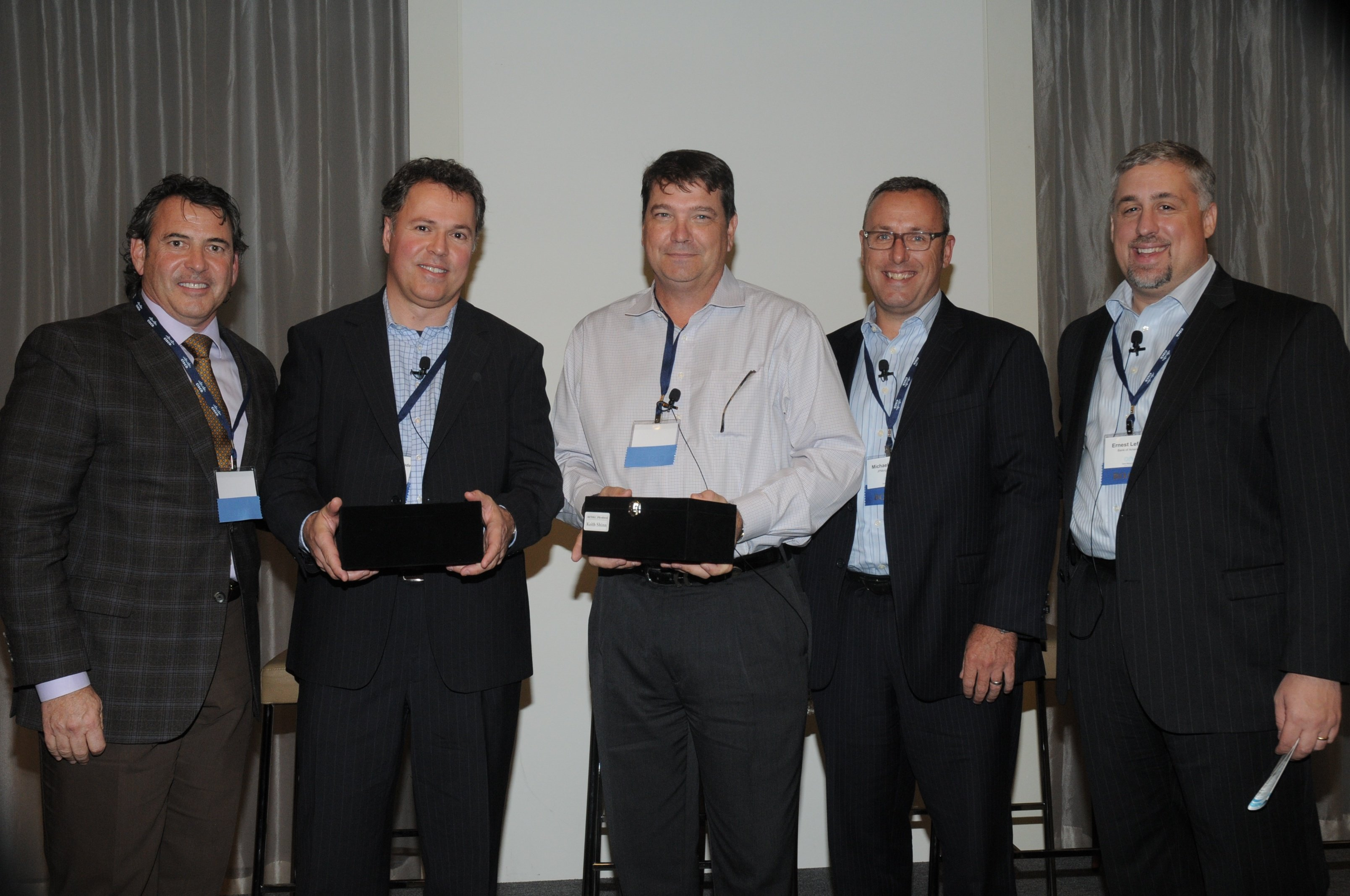 New ONUG Board members Harmen Van der Linde, Citigroup, and Keith Shinn, Fidelity Investments, accept membership awards from fellow board members Nick Lippis of Lippis Enterprises, Michael Payne of JPMorgan Chase, and Ernest Lefner of Bank of America