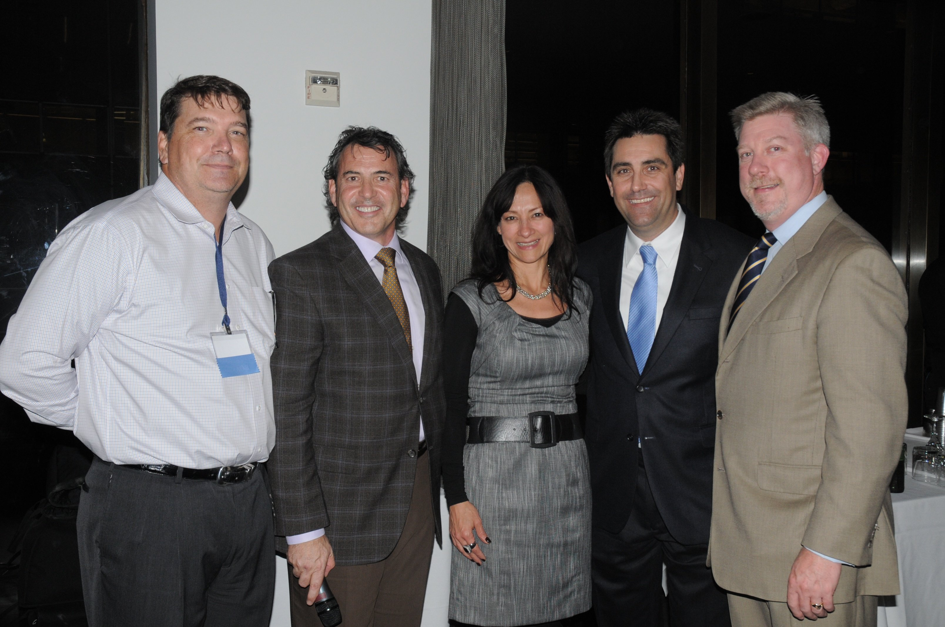 ONUG Board members Keith Shinn and Nick Lippis with the Intel team at the ONUG Dinner reception
